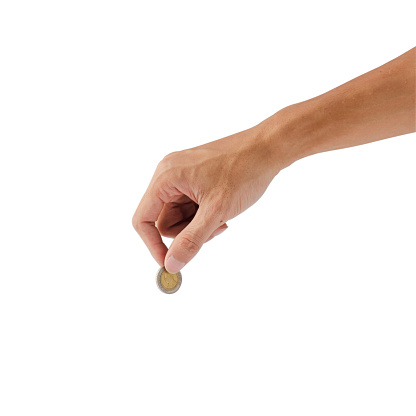 Female hand holding coin isolated on white background with clipping path.